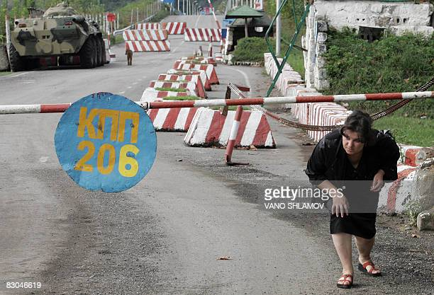 COLEMAN 'GeorgiaRussiaconflictborder' Picture taken on September 27 2008 shows a woman crossing the Abkhazian border check point in Khurcha Awaiting...