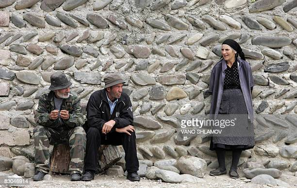 SNEGAROFF 'GeorgiaRussiaconflictSOssetia' A picture taken on September 26 2008 shows two men and a woman near a stone fence in a village of Akhmaji...