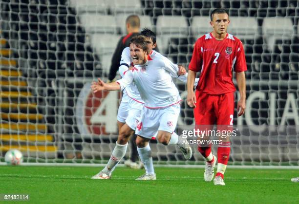 Georgia's Beka Gotsiridze celebrates after scoring the winning goal during the International friendly football match against Wales at the Liberty...
