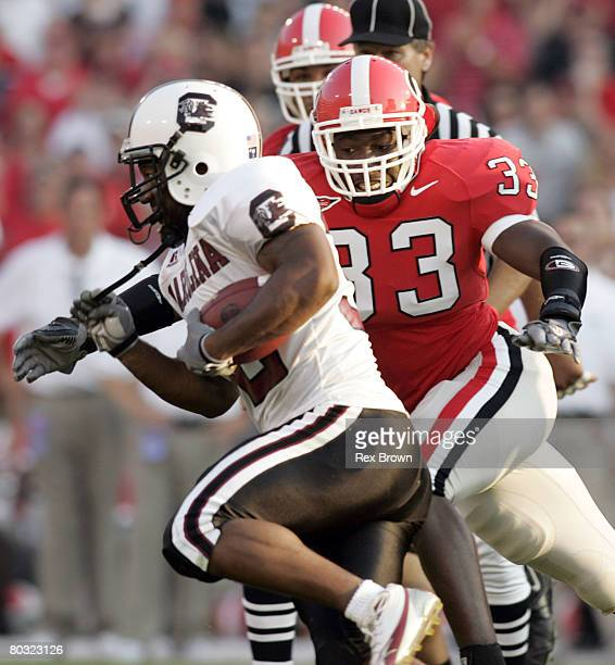 Georgia's Dannell Ellerbe runs down South Carolina's Daccus Turman during the first half on September 10 at Sanford Stadium in Athens Georgia