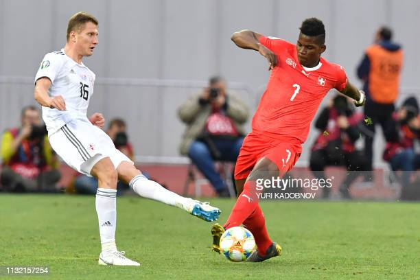 Georgia's defender Jemal Tabidze and Switzerland's forward Breel Embolo vie for the ball during the Euro 2020 football qualification match between...
