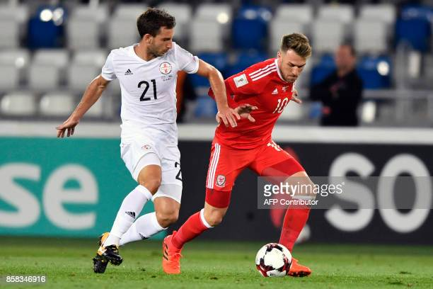 Georgia's defender Otar Kakabadze and Wales' midfielder Aaron Ramsey vie for the ball during the FIFA World Cup 2018 qualification football match...