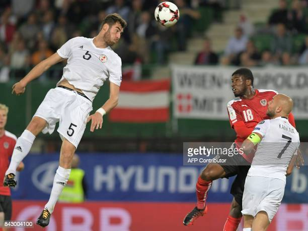 Georgia's defender Solomon Kverkvelia and Austria's midfielder Kevin Danso vie for the ball during the Group D FIFA World Cup 2018 qualification...