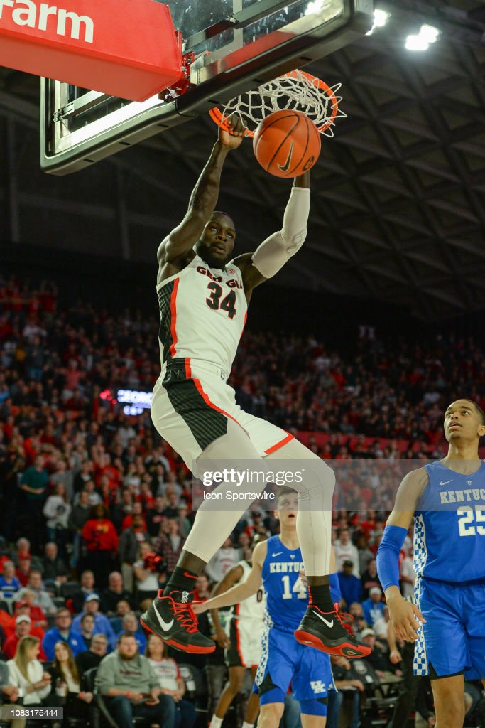 Georgia's Derek Ogbeide slams home two points during the