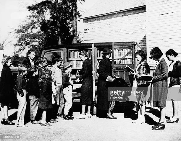 Georgia's first WPA bookmobile in Thomas County, Georgia. Employees include one WPA and two NYA workers.