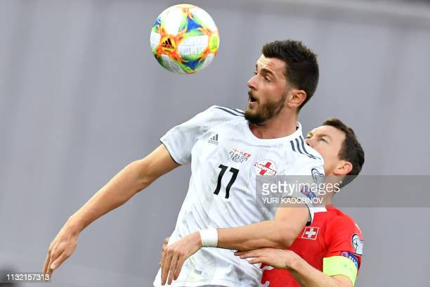 Georgia's forward Giorgi Kvilitaia and Switzerland's defender Stephan Lichtsteiner vie for the ball during the Euro 2020 football qualification match...