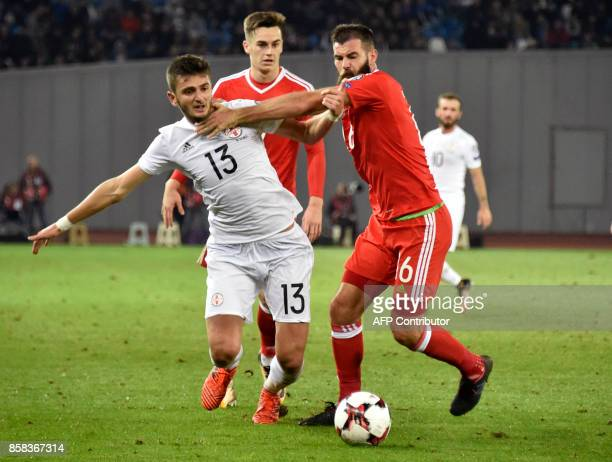 Georgia's forward Giorgi Kvilitaia and Wales' midfielder Joe Ledley vie for the ball during the FIFA World Cup 2018 qualification football match...