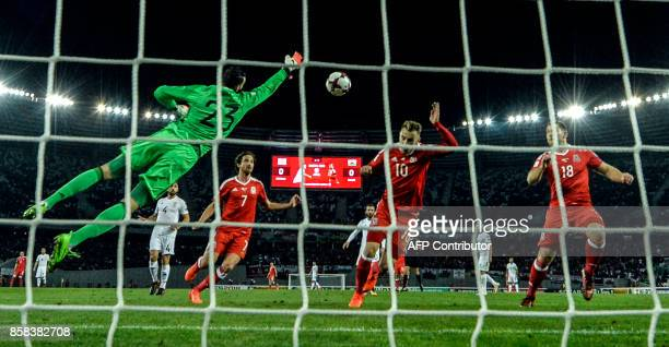 Georgia's goalkeeper Giorgi Loria jumps to make a save during the FIFA World Cup 2018 qualification football match between Georgia and Wales in...