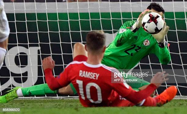 Georgia's goalkeeper Giorgi Loria stops the ball during the FIFA World Cup 2018 qualification football match between Georgia and Wales in Tbilisi on...
