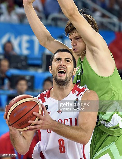 Georgia's guard George Tsintsadze vies with Slovenia's guard Jaka Klobucar during the Group C qualifying basketball match between Slovenia and...