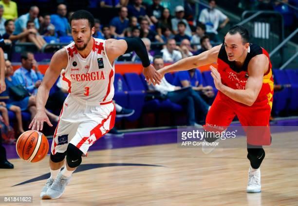 Georgia's guard Michael Dixon Jr dribbles the ball past Germany's shooting guard Karsten Tadda during their FIBA EuroBasket 2017 basketball...