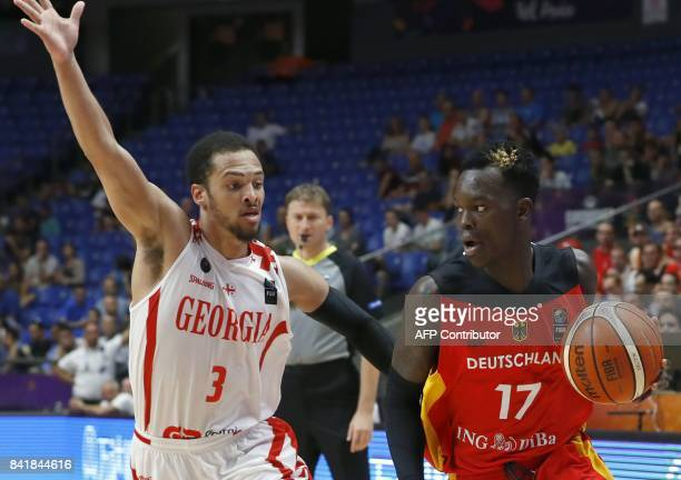 Georgia's guard Michael Dixon Jr marks Germany's point guard Dennis Schroder during their FIBA EuroBasket 2017 basketball championship match between...