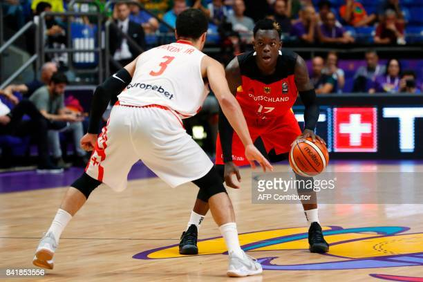Georgia's guard Michael Dixon Jr vies for the ball with Germany's point guard Dennis Schroder during their FIBA EuroBasket 2017 basketball...