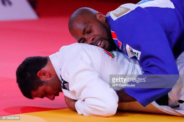 Georgia's Guram Tushishvili competes against France's Teddy Riner during the Judo World Championships Open 2017 in the Moroccan city of Marrakesh on...