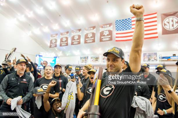 Georgia's Head Coach Petros Kyprianou raises a fist in the air after his Women's team wins the 2018 Division I Men's and Women's Indoor Track Field...