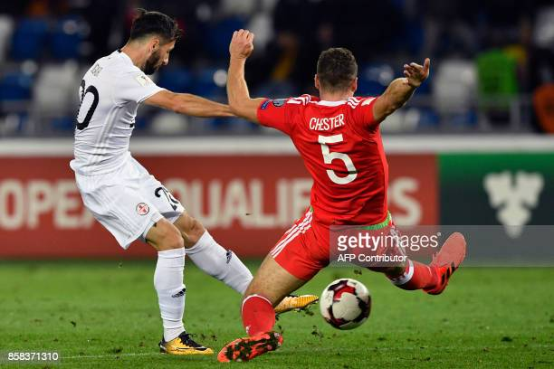 Georgia's Jambul Jigauri and Wales' defender James Chester vie for the ball during the FIFA World Cup 2018 qualification football match between...