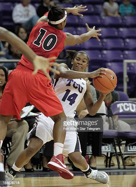 Georgia's Jasmine James applies pressure as Texas Christian's Zahna Medley looks for a passing lane at DanielMeyer Coliseum in Fort Worth Texas on...