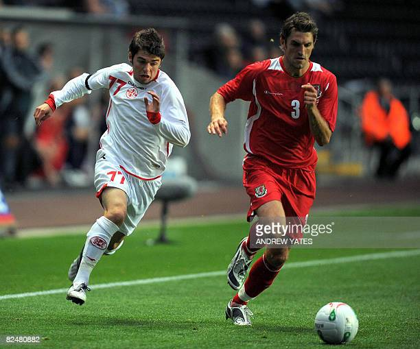 Georgia's Levan Kenia vies with Wales Sam Ricketts during an international friendly football match at the Liberty Stadium in Swansea South Wales on...