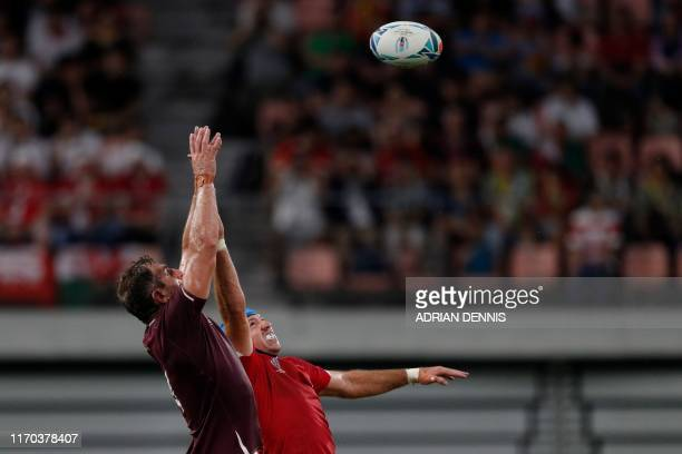 TOPSHOT Georgia's lock Giorgi Nemsadze and Wales' flanker Justin Tipuric jump for the ball in a line out during the Japan 2019 Rugby World Cup Pool D...