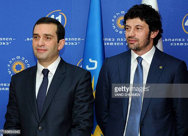 Georgia's new minister for infrastructure and regional development Kakha Kaladze and defence minister Irakli Alasania attend a ceremony to present...