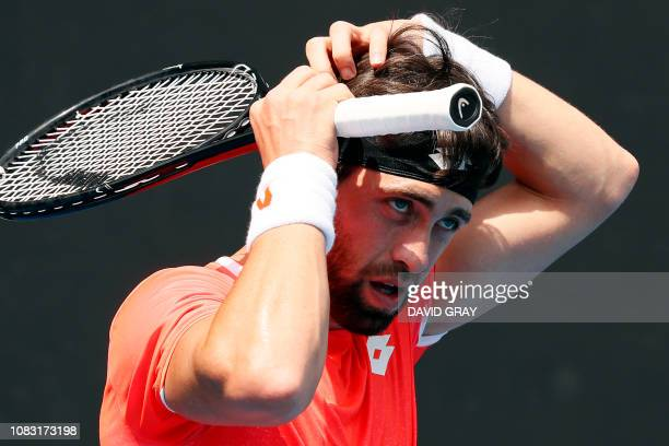 Georgia's Nikoloz Basilashvili gets ready to serve against Stefano Travaglia of Italy during their men's singles match on day three of the Australian...
