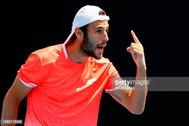 Georgia's Nikoloz Basilashvili reacts after a point against Italy's Stefano Travaglia during their men's singles match on day three of the Australian...