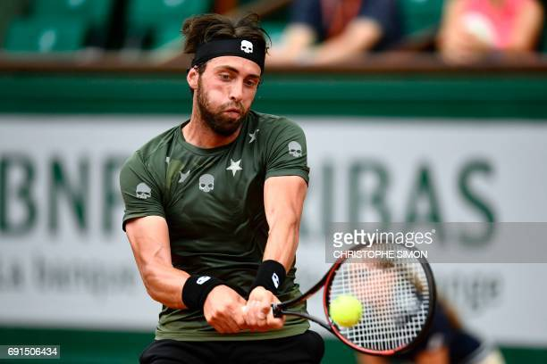 Georgia's Nikoloz Basilashvili returns the ball to Spain's Rafael Nadal during their tennis match at the Roland Garros 2017 French Open on June 2...