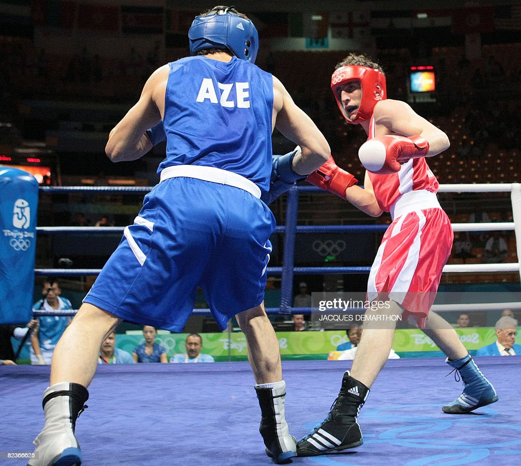 Georgia's Nikoloz Izoria (R) fights against Azerbaijan's Imranov Shahin during their 2008 Olympic Games Featherweight (57 kg) boxing bout on August 15, 2008 in Beijing.