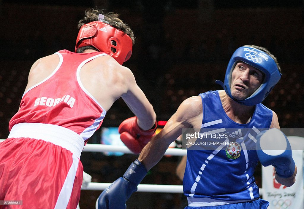 Georgia's Nikoloz Izoria (L) fights against Azerbaijan's Imranov Shahin during their 2008 Olympic Games Featherweight (57 kg) boxing bout on August 15, 2008 in Beijing.