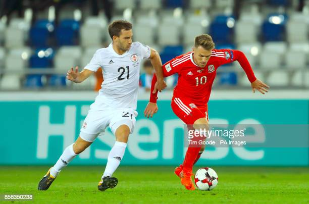 Georgia's Otar Kakabadze and Wales' Aaron Ramsey battle for the ball during the 2018 FIFA World Cup Qualifying Group D match at the Boris Paichadze...