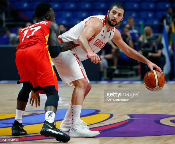 Georgia's point guard George Tsintsadze is marked by Germany's point guard Dennis Schroder during their FIBA EuroBasket 2017 basketball championship...