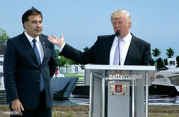 Georgia's President Mikheil Saakashvili and US property mogul Donald Trump speak in the Georgian Black sea resort of Batumi on April 22 during a...