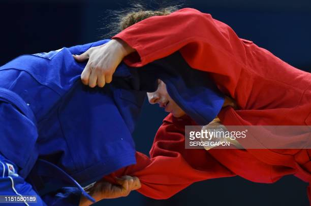 Georgia's Salome Abashidze competes against Moldova's Sabina Artemciuc in the womens sambo under 60 kg category quarterfinal bout at the 2019...