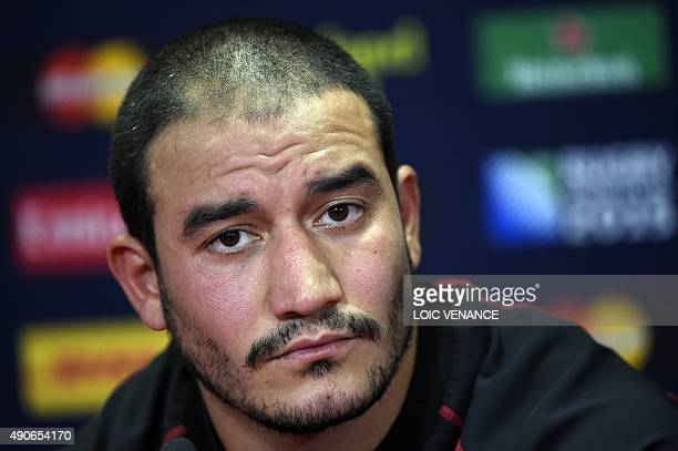 Georgia's scrum half Giorgi Begadze attends a press conference following the captain's run at the Millennium stadium in Cardiff south Wales on...
