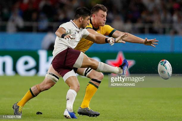 Georgia's scrum-half Gela Aprasidze kicks the ball past Australia's wing Dane Haylett-Petty during the Japan 2019 Rugby World Cup Pool D match...
