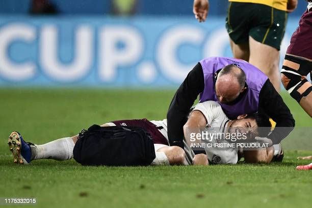 Georgia's scrum-half Gela Aprasidze receives medical attention during the Japan 2019 Rugby World Cup Pool D match between Australia and Georgia at...