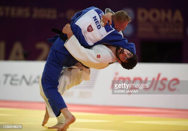 Georgia's Tato Grigalashvili and Netherlands' Frank De Wit fight during the men's under 81kg category of the World Judo Masters in the Qatari capital...