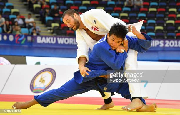 TOPSHOT Georgia's Varlam Liparteliani fights against South Korea's Cho Guham in the men's under 100kg category gold medal bout of the 2018 Judo World...