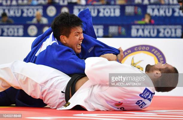 Georgia's Varlam Liparteliani fights against South Korea's Cho Guham in the men's under 100kg category gold medal bout of the 2018 Judo World...