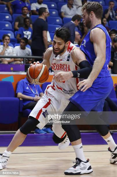 Georgia's Zaza Pachlia vies with Italy's Nicolo Melli during the FIBA EuroBasket 2017 championship match between Georgia and Italy at Menora...
