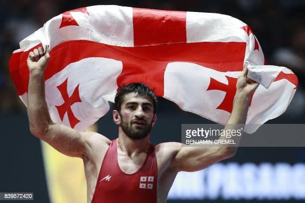 Georgia's Zurabi Iakobishvili celebrates after winning the men's freestyle wrestling -65kg category final at the FILA World Wrestling Championships...