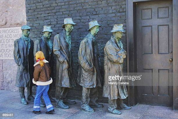 Georgie Cox touches George Segals sculpture of a 1930s bread line which captures the hunger and desperation that many Americans felt during the...