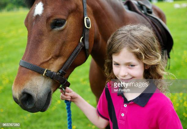 Georgie Gospel holds her horse Rosie during the Duncombe Park Country Fair on May 28 2018 in Helmsley England Set in the grounds of one of...