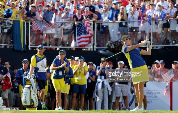 Georgie Hall of England and the European Team plays her tee shot on the first hole in her match against Paula Creamer of the United States team...