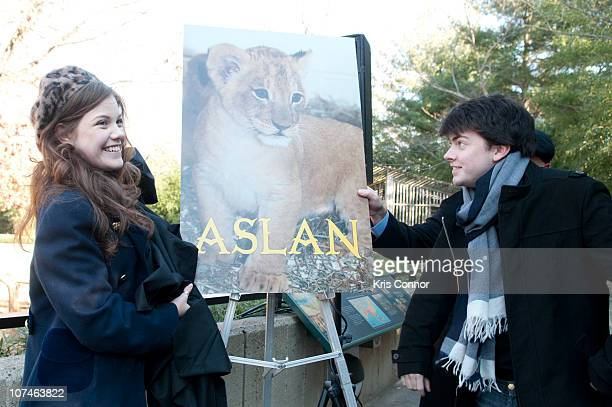 Georgie Henley and Skandar Keynes pose for a photo during the Smithsonian's National Zoo Lion Cub naming ceremony at Smithsonian National Zoological...