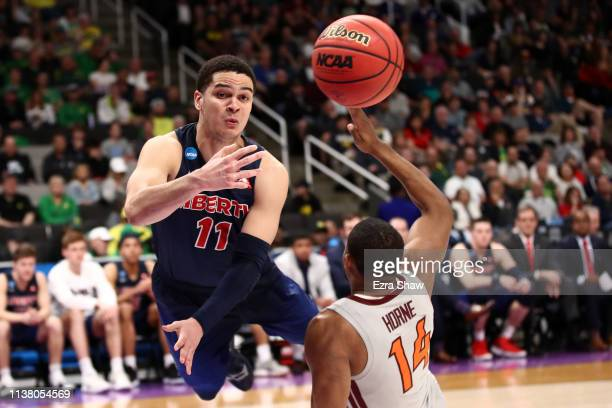 Georgie PachecoOrtiz of the Liberty Flames collides with PJ Horne of the Virginia Tech Hokies in the second half during the second round of the 2019...