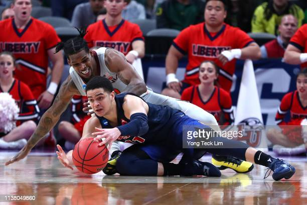 Georgie PachecoOrtiz of the Liberty Flames competes for a loose ball with Ahmed Hill of the Virginia Tech Hokies in the second half during the second...
