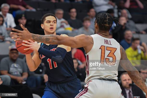 Georgie PachecoOrtiz of the Liberty Flames looks for a teammate in front of Ahmed Hill of the Virginia Tech Hokies in the second round of the 2019...