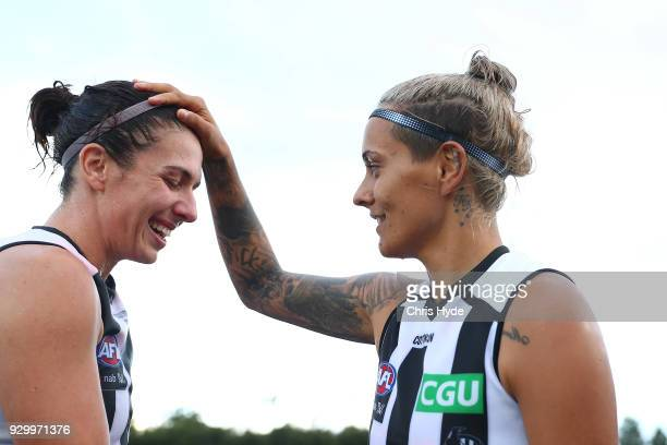 Georgie Parker and Moana Hope of the Magpies celebrate winning the round six AFLW match between the Brisbane Lions and the Collingwood Magpies at...