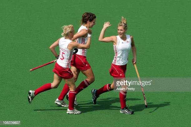 Georgie Twigg of England celebrates with her team mates Alex Danson and Ashleigh Ball after scoring the opening goal during the women's finals bronze...